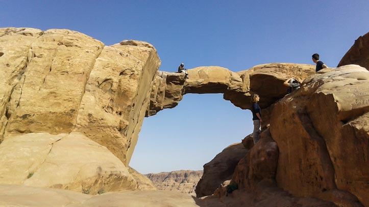 Fawaz sitting on Burdah rock bridge