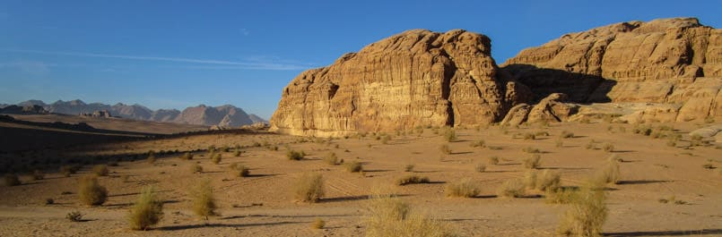 Yellow sandstone mountains of Wadi Rum desert illuminated by the morning sun