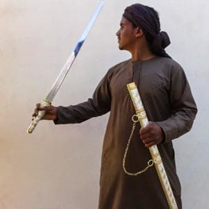 Abdullah showing the sword won in a camel race