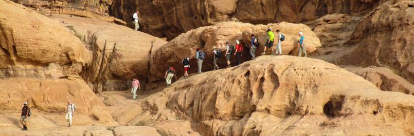 Climbing Burdah rock bridge in Wadi Rum desert in 24 hours program