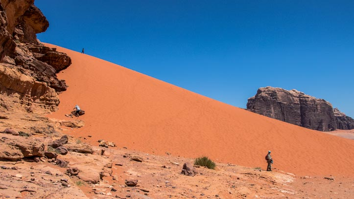 Red sand dune with Jabal Rum in the background