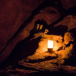 Candle lighting a part of a cave during a overnight stay in Wadi Rum desert