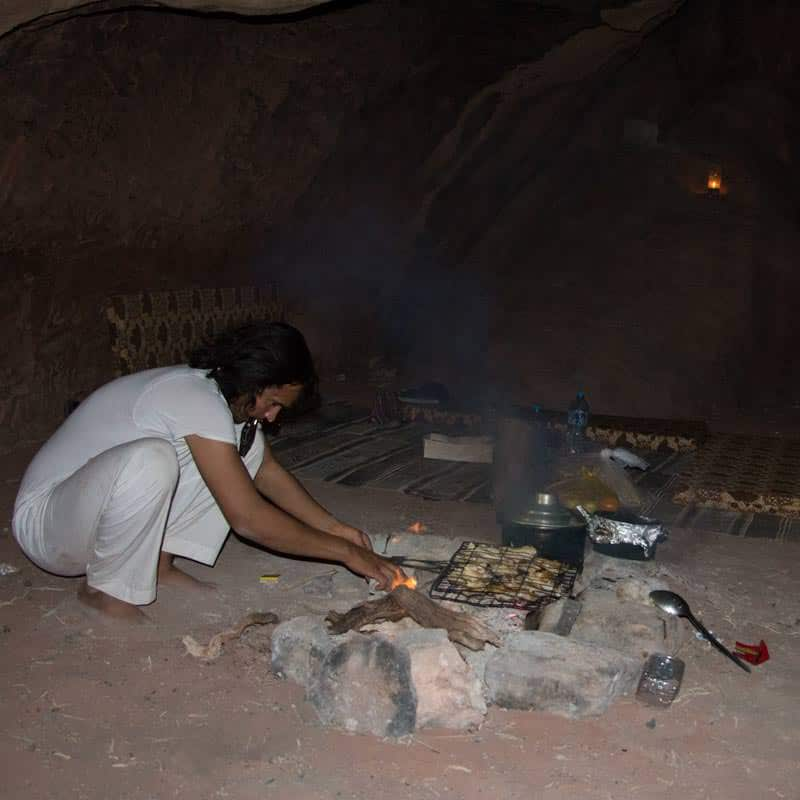 Fawaz preparing food over the wood fire