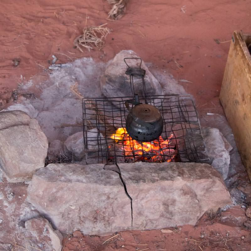 Preparing Bedouin tea over the wood fire