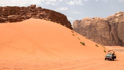 Red sand dune backed by Jabal Um Ishrin in Wadi Rum desert