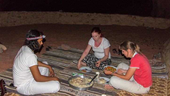 Having dinner bivouac style in Wadi Rum desert