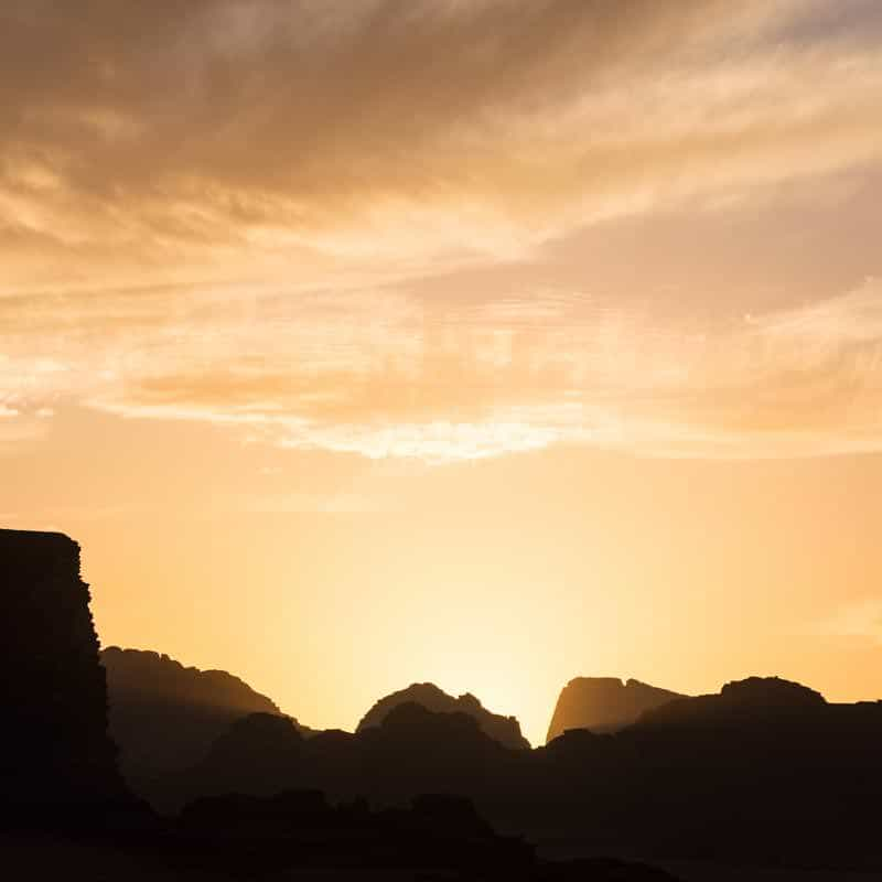 Silver grey sunset and beautiful mountain skyline in Wadi Rum desert