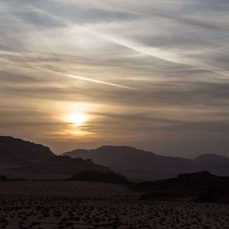 Pretty sunset on a cloudy day in Wadi Rum desert