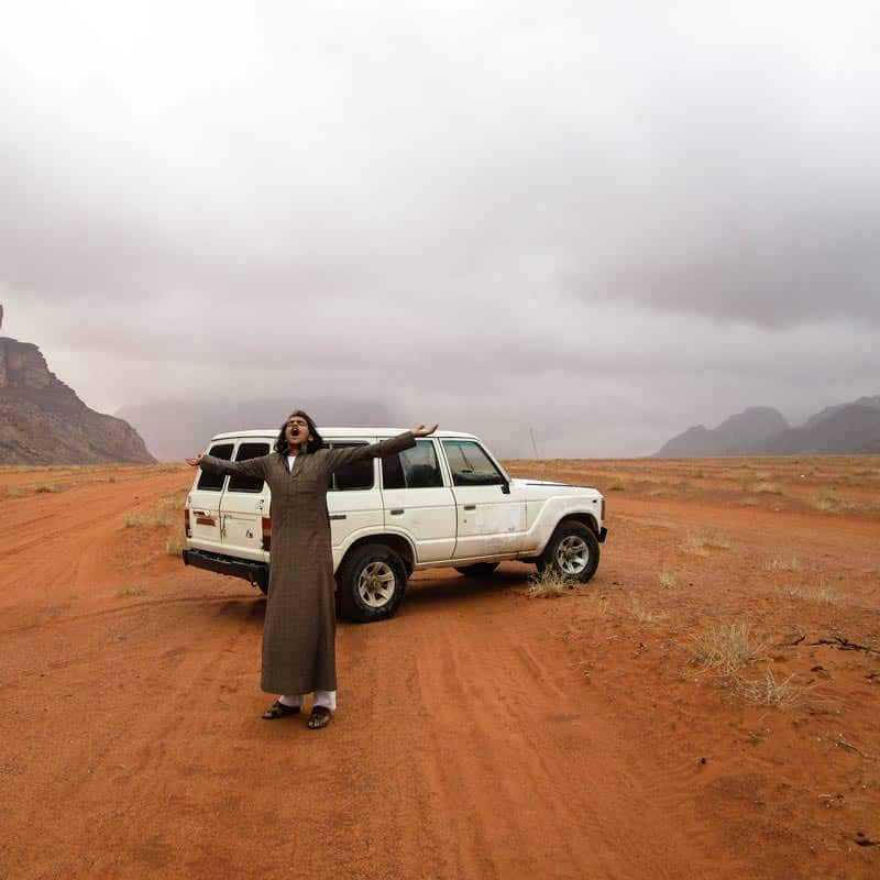Fawaz celebrating rain in Wadi Rum desert