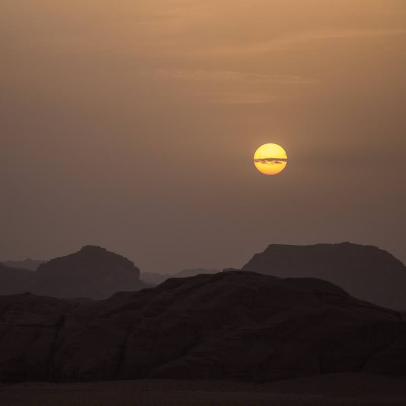 Stunning sunset on a overcast day in Wadi Rum desert