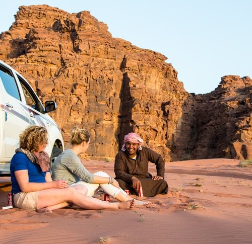 Nawaf enjoying sunset with our guests