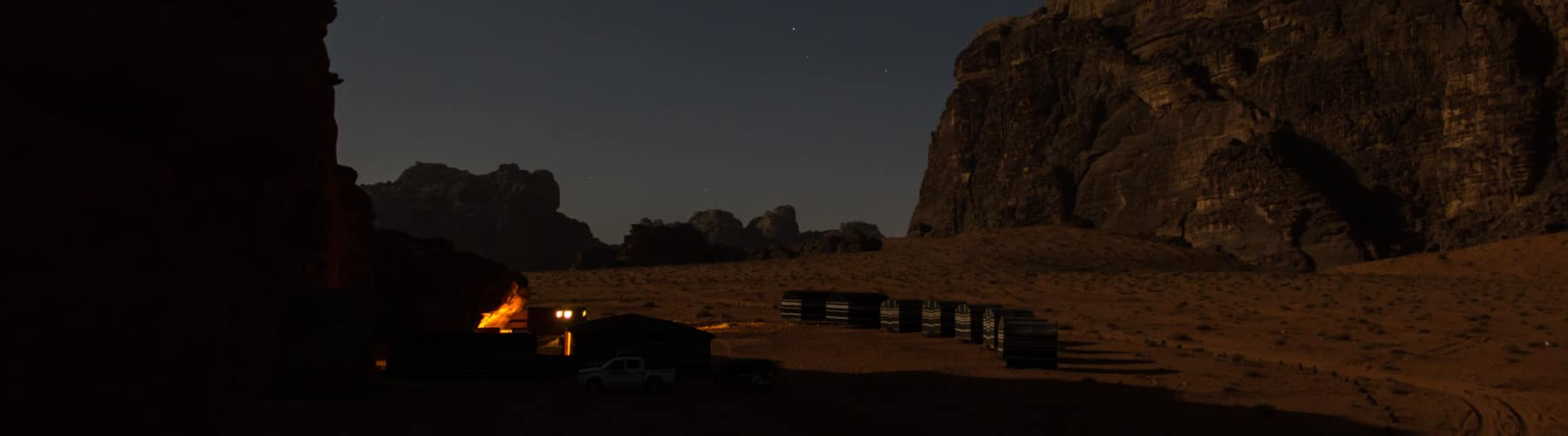overview of Wadi Rum Base Camp on a full moon night