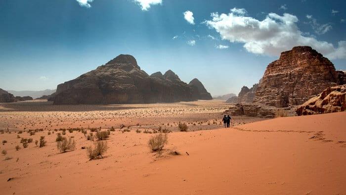 guests trekking in wadi rum desert