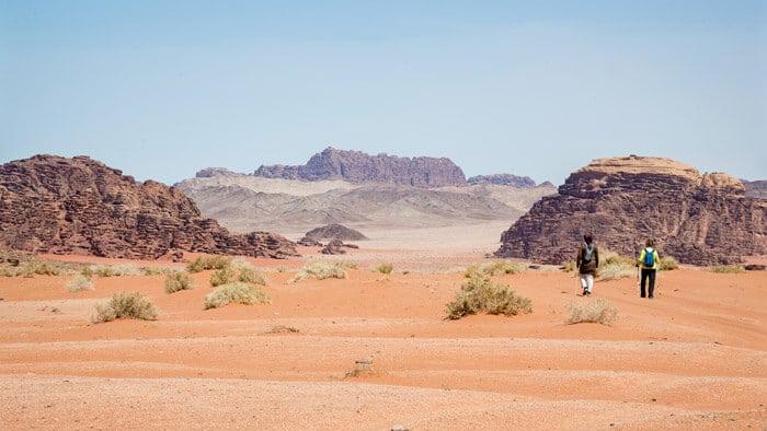 guide and guest trekking wadi rum
