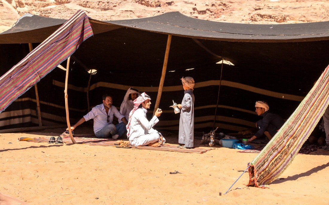 bedouin hospitality serving coffee in tent in desert