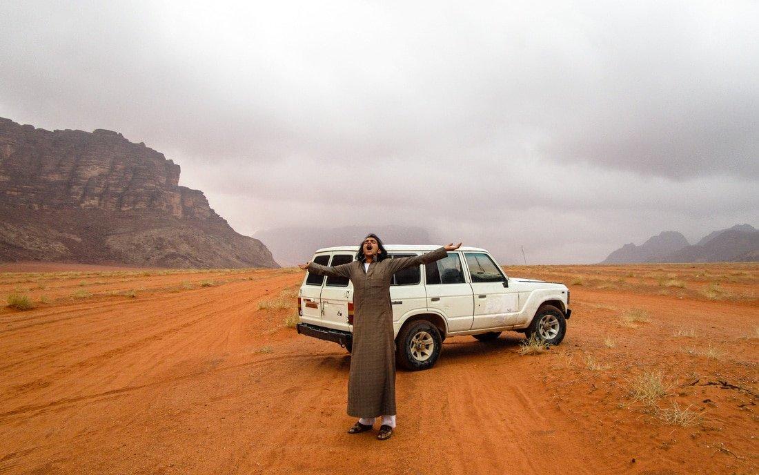 fawaz enjoying the rain in wadi rum desert