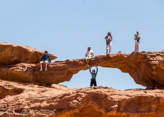 guests enjoying on little bridge while on a Wadi Rum jeep tour with wadi rum nomads