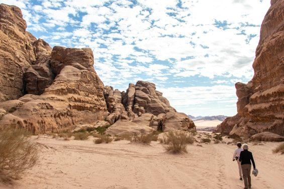 guests hiking in wadi nuqra during the desert tour wadi sabet