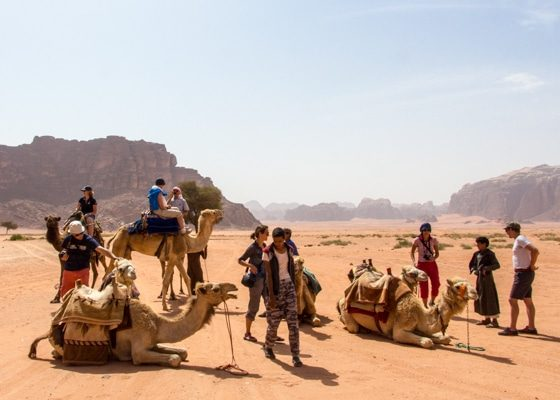 guests on a wadi rum camel ride stopping at a site