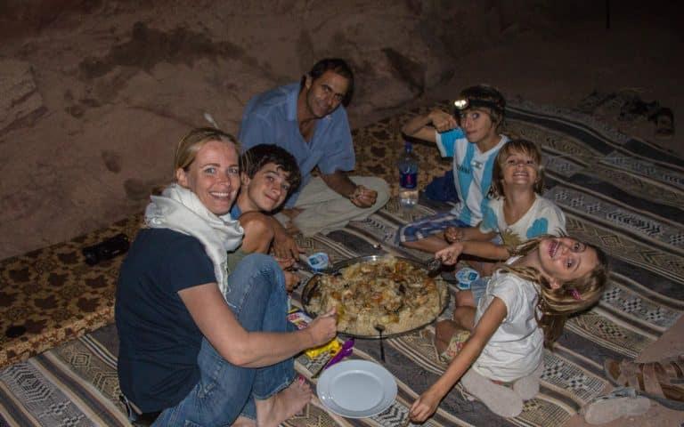 eating magloubah in the desert