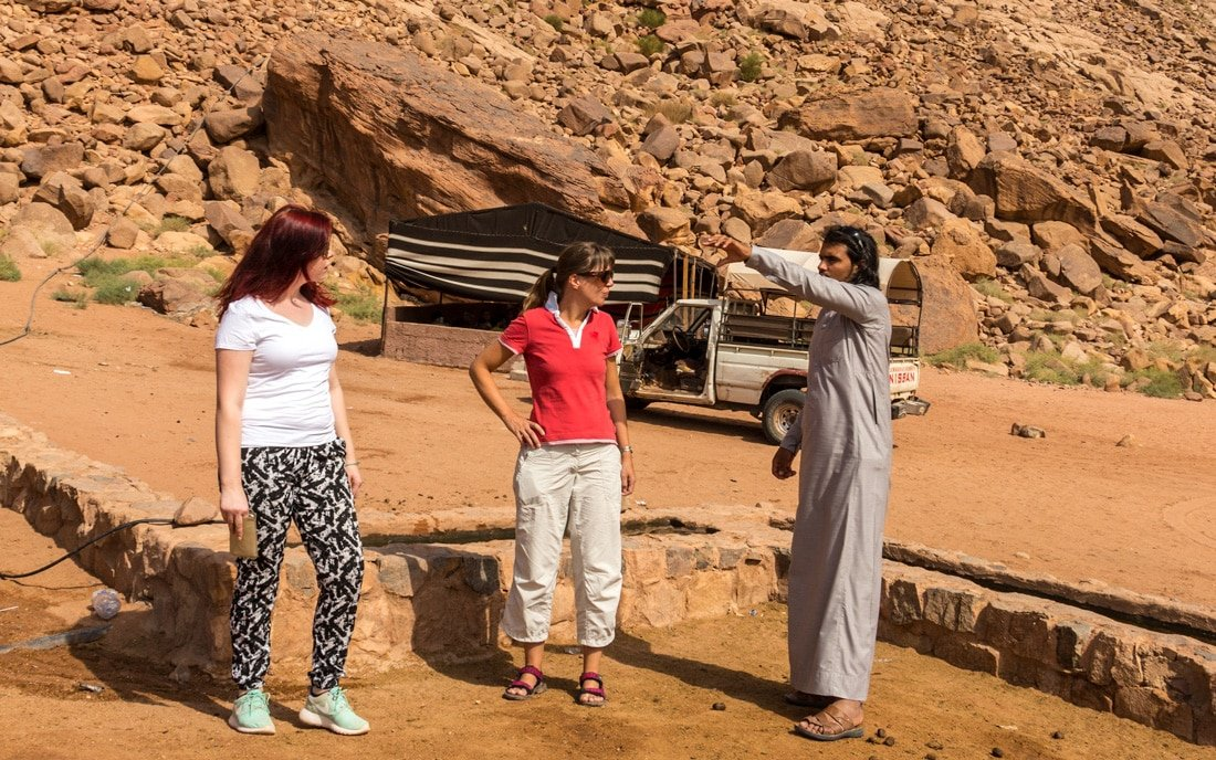tour guide explaining about a site to guests