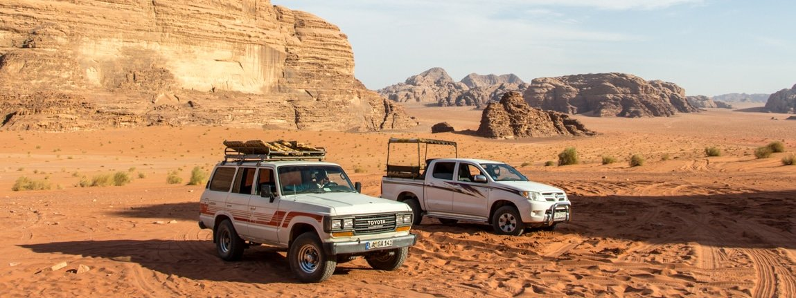 wadi rum - car parked at a lawrence house during a full day jeep tour