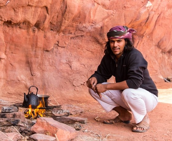 fawaz mohammad, owner of wadi rum nomads preparing tea over the fire