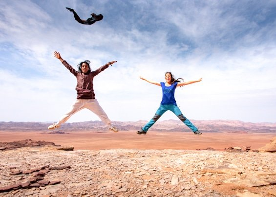 guide and guest expressing their feeling of freedom on jabal al-hash