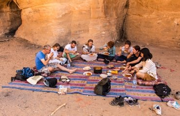 wadi rum - guests having lunch while on full day jeep tour with wadi rum nomads