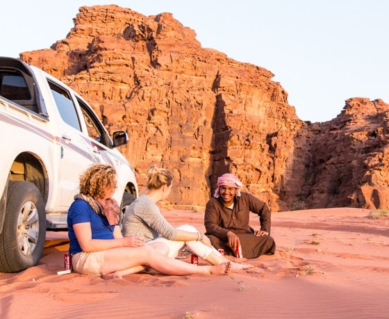 nawaf enjoying the sunset with guests in wadi rum