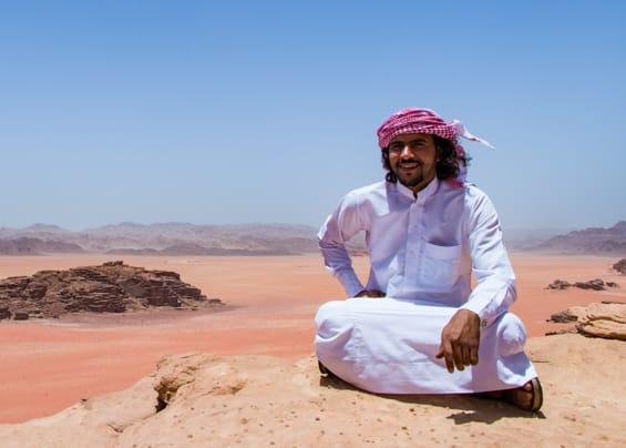wadi rum nomads - fawaz mohammad sitting on the ridge of the wadi sabet viewpoint