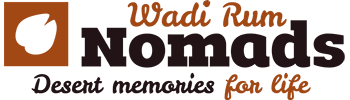 logo of wadi rum nomads with its slogan