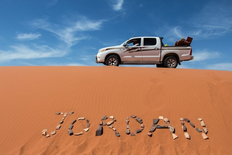 our toyota hilux parked on a dune in wadi rum