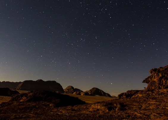 starry night sky view from the wadi rum nomads cave while bivouac camping