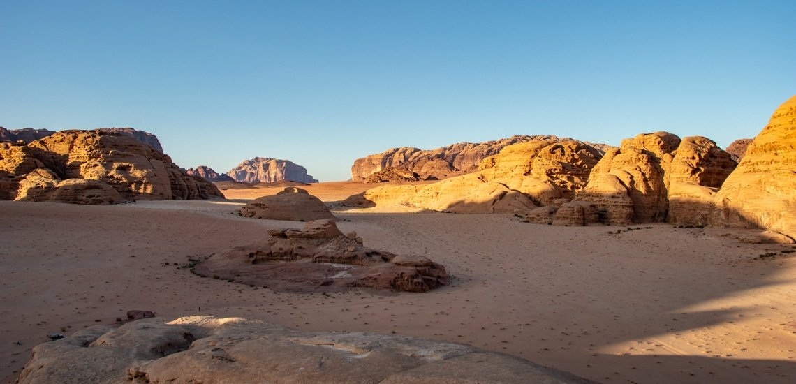 view on wadi rum while on tour with wadi rum nomads around sunset time